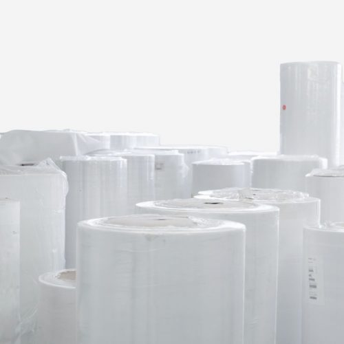 Rolls of non-woven fabric packed